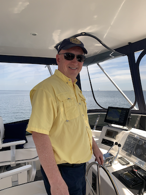 Captain John at the helm